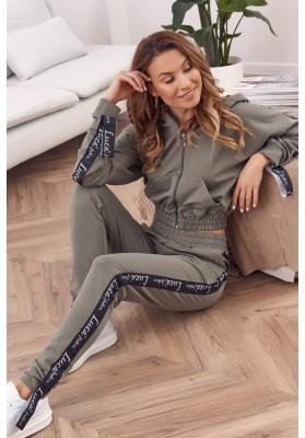 Moderní, dámské pohodlné kalhoty se zapínáním na zip a knoflík, hnědé